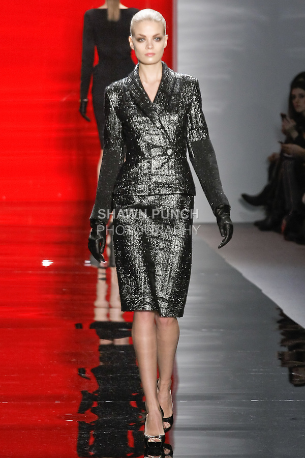 Franziska walks runway in a bonne nuit metallic plaid double- breasted jacket over bonne nuit metallic plaid slim pencil skirt, from the Reem Acra Fall 2012 Feminine Power collection fashion show, during Mercedes-Benz Fashion Week New York Fall 2012 at Lincoln Center.