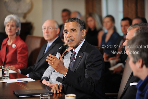 United States President Barack Obama speaks at a Cabinet Meeting in the Cabinet Room at the White House in Washington, DC., Monday, October 3, 2011.  U.S. Secretary of Health and Human Services Kathleen Sebelius and U.S. Secretary of the Interior Ken Salazar can be seen at left..Credit: Olivier Douliery / Pool via CNP
