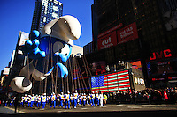 USA, NEW YORK, November 24, 2011.A Smurf balloon floats in Times Square while American celebrated the Macy's Thanksgiving day parade in New York, November 24,2011. VIEWpress / Eduardo Munoz Alvarez..The Macy's parade is considered by many to be the official start of the holiday season. Balloons, bands and dignitaries trooped through midtown Manhattan Thursday morning for the 85th annual Macy's Thanksgiving Day Parade. Media Reported.