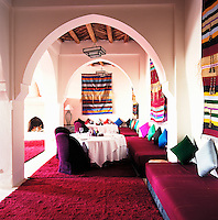 Deep red hand-woven rugs by local artisans cover the floors of the dining room