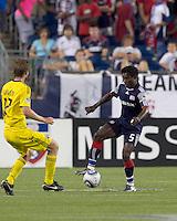 New England Revolution defender Emmanuel Osei (5) controls the ball as Columbus Crew midfielder Eddie Gaven (12) closes. The New England Revolution tied Columbus Crew, 2-2, at Gillette Stadium on September 25, 2010.