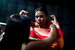 A model for the Brazilian brand, Neon, gets dressed backstage at São Paulo Fashion Week for Summer Season 2013/2014, at Bienal, in São Paulo, Brazil, on Wednesday, March 20, 2013.