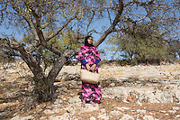 "Morocco - Tidzi - Fatima Oumissi, 32, from Idmine. Oumissi is the mother of two children, aged 12 and 6, and is currently 3-month-pregnant. The woman joined Ajddigue in 2010 in order to increase the earnings of her family. Married with a fisherman who spends most of the week far from Tidzi, Oumissi works at the cooperative only half a day, as she also has to look after the house and bring her kids to school. ""I like to work here and spend time with other women"" she explain. ""We talk about our problems and have fun together. There is a lot of complicity."""