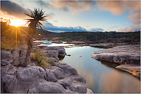 I waited for a while in hopes the sun would break through some low clouds on this morning in the Texas Hill Country. My patience was rewarded when the sun burst over the horizon and gave light to the Pedernales River and Pedernales Falls State Park.