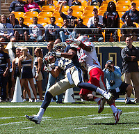 Pitt freshman wide receiver Tyler Boyd (23) makes a 51-yard reception despite pass interference by New Mexico cornerback Cranston Jones (3). The Pitt Panthers defeated the New Mexico Lobos 49-27 on Saturday, September 14, 2013 at Heinz Field, Pittsburgh, Pennsylvania.