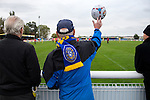 Concord Rangers 0 Hayes and Yeading United 3, 17/10/2015. Thames Road, Football Conference South. Concord Rangers in play host to Hayes and Yeading United in a Conference South League match. The match was won by the away side by 3 goals to 0. Thames Road Stadium is sandwiched between a caravan park and a gas works on Canvey Island. A Concord supporter throws the ball back. Photo by Simon Gill