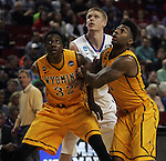 Wyoming's Alan Herndon (32) and Charles Hankerson (1) box out Northern Iowa's Paul Jesperson (4) in the 2015 NCAA Division I Men's Basketball Championship March 20, 2015 at the Key Arena in Seattle, Washington.   Northern Iowa beat Wyoming 71 to 54.   ©2015.  Jim Bryant Photo. All Rights Reserved.