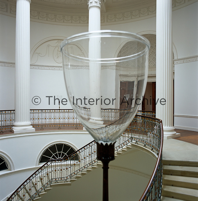 One of several glass lanterns located on the landing of the cantilevered staircase of the central rotunda