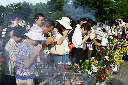 Aug. 06, 2010 ; Hiroshima, JPN - Visitors burn incense, offer flowers and pray at the 2010 Hiroshima Peace Memorial Ceremony in Peace Park.