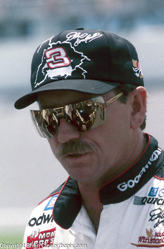 Dale Earnhardt's Chevrolet is reflected in his glasses at Daytona in July 1996. (Photo by Brian Cleary/www.bcpix.com)