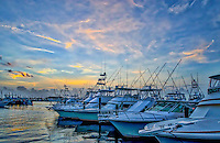 This is a sunset over the marina in Port A Texas as the sky lite up with color at the last few moments of the day with the fishing boats all lined up ready to go out the next day.