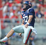Ole Miss' Tyler Campbell (97) punts at Vaught-Hemingway Stadium in Oxford, Miss. on Saturday, September 24, 2011. Georgia won 27-13.