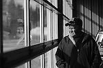 Mike Riggen, the fire chief of Carmichaels and the sole coordinator of the 59th Bituminous Coal Festival, stares out the garage windows of his fire station in Jan. 2013. Riggen struggles with funding and interest in the festival but refuses to let it die.