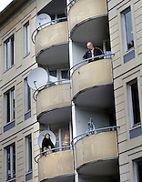 (Oslo July 26, 2011)  Neighbours look on as VIPs visit the mosque World Islamic Mission in Oslo. following the terrorist attacks...A large vehicle bomb was detonated near the offices of Norwegian Prime Minister Jens Stoltenberg on 22 July 2011. .Another terrorist attack took place shortly afterwards, where a man killed 68 people, mainly children and youths attending a political camp at Utøya island. ..Anders Behring Breivik was arrested on the island and has admitted to carrying out both attacks..(photo:Fredrik Naumann/Felix Features)