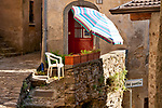 Stone houses and cobble stone streets in Nesso, a small town on Lake Como, Italy