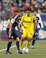 New England Revolution defender Chris Tierney (8) passes the ball as Columbus Crew midfielder Milovan Mirosevic (10) closes. In a Major League Soccer (MLS) match, the New England Revolution tied the Columbus Crew, 0-0, at Gillette Stadium on June 16, 2012.