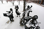 The orchestra plays on despite a fresh snowfall on the Drake University campus in Des Moines, Iowa.  The bronze sculpture, &quot;The Joy of Music&quot;, by artist George Lundeen, sits in front of the Fine Arts Building.