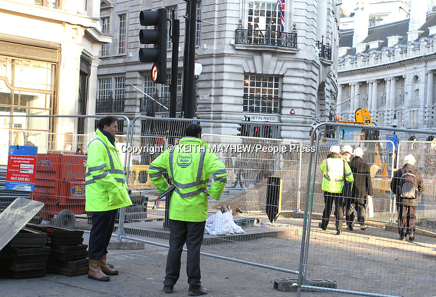 London - London's Regent Street - usually one of the busiest shopping streets in the capital - is still closed to traffic, as work continues on burst water main. The street has been closed to traffic since Saturday and it is expected to be at least 2 more days until Thames Water engineers can repair the damage. Regent Street, London - March 6th 2013..Photo by Keith Mayhew