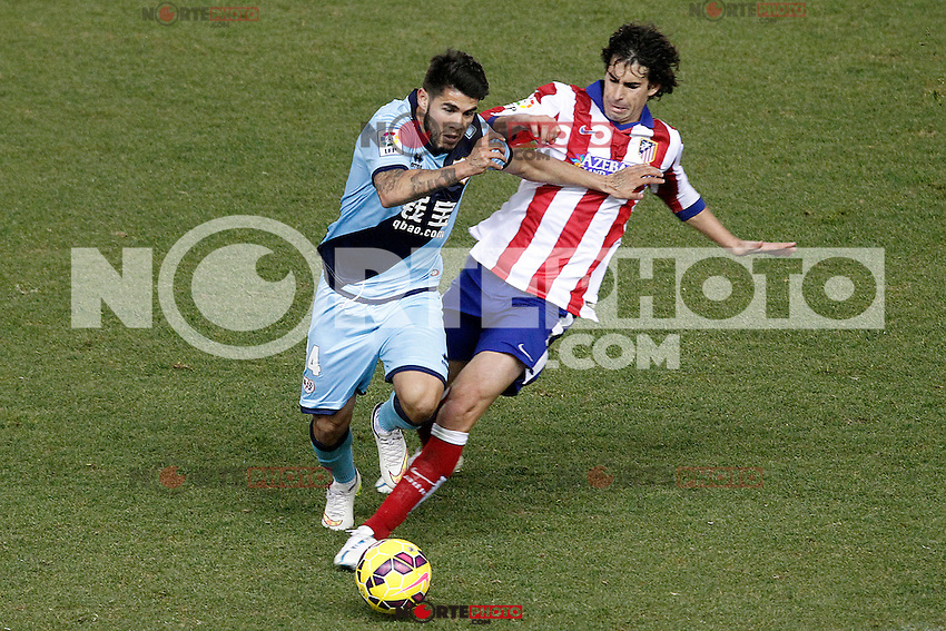 Atletico de Madrid's Tiago Mendes (r) and Rayo Vallecano's Alejandro Pozuelo during La Liga match.January 24,2015. (ALTERPHOTOS/Acero) /NortePhoto<br />