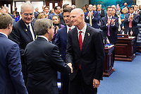 TALLAHASSEE, FLA. 11/18/14-ORGSESS111814CH-Gov. Rick Scott, right, congratulates Rep. Scott Plakon, R-Longwood, after he took the oath of office during Organizational Session, Nov. 18, 2014 at the Capitol in Tallahassee.<br /> <br /> COLIN HACKLEY PHOTO