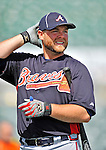 13 March 2012: Atlanta Braves catcher Brian McCann awaits his turn in the batting cage prior to a Spring Training game against the Miami Marlins at Roger Dean Stadium in Jupiter, Florida. The two teams battled to a 2-2 tie playing 10 innings of Grapefruit League action. Mandatory Credit: Ed Wolfstein Photo