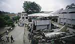 A MIG-21, whose pilot supposely shot down 16 American and Chinese warplanes, lords over fragments of enemy aircraft at the Military Museum in Hanoi, North Vietnam. (Jim Bryant Photo)....