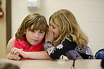 Ashley Spencer whispers Taylor Nitz a secret on Appalachian Day at Beattyville Elementary on October 1, 2010.  Both girls are in the 3rd grade. .Photo by Latara Appleby