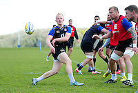 Will Homer of Bath Rugby passes the ball. Bath Rugby training session on May 3, 2016 at Farleigh House in Bath, England. Photo by: Patrick Khachfe / Onside Images
