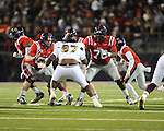 Ole Miss center Evan Swindall (56) and Ole Miss offensive lineman Emmanuel McCray (70) block Mississippi State defensive lineman Josh Boyd (97) at Vaught-Hemingway Stadium in Oxford, Miss. on Saturday, November 24, 2012. Ole Miss won 41-24.