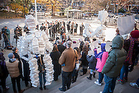 A coalition of environmental groups gather at a rally at City Hall in New York on Monday, November 25, 2013 prior to a hearing by the NY City Council Sanitation and Waste subcommittee on restrictions on polystyrene items.The coalition contends that the plastic, with the trade name Styrofoam, is not recyclable and ends up costing the city millions of dollars to process through the waste stream.  Other cities have already banned the polystyrene which is not biodegradable.  (© Richard B. Levine)