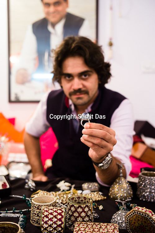Siddharth Kasliwal of Gem Palace shows expensive diamond ring in his office in Jaipur, Rajasthan, India. The portrait of his father, Munnu Kasliwal is seen in the background.