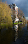 Canal and apartments near Heemstedestraat, Amsterdam - a stark contrast to the classic beauty of central Amsterdam. There's an obsessive sense of order within chaos in dutch urban planning...