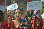 Women gather to celebrate International Women's Day on March 8, 2016, in Dhawa, a village in the Gorkha District of Nepal.<br /> <br /> The woman on the left holds a sign reading, &quot;We demand equality.&quot;
