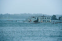 Newport, RI - The harbor floods over the piers on Goat Island during super storm Sandy.