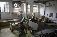 India – West Bengal: Workers sorting tea at the processing factory at Makaibari Tea Estates, in the Darjeeling region. Here, leaves are fermented, dried and packed. Tea industry was first introduced in West Bengal during colonialism by the British, which kept on managing most of the tea estates until the 60s.