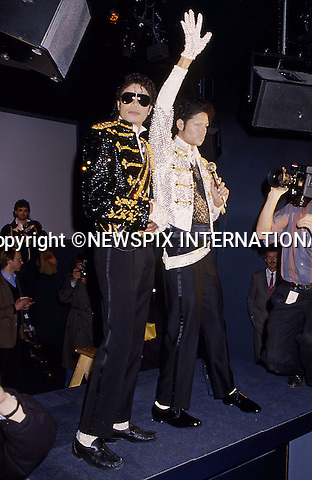 "MICHAEL JACKSON.Died today at UCLA Hospital Los Angles (25/06/2009) after suffering a heart attack and slipping into a coma at the age of 50...Michael Jackson at Madame Tussaud with his waxwork, London 1985.Mandatory Photo Credit: ©Francis Dias/Newspix International..**ALL FEES PAYABLE TO: ""NEWSPIX INTERNATIONAL""**..PHOTO CREDIT MANDATORY!!: NEWSPIX INTERNATIONAL(Failure to credit will incur a surcharge of 100% of reproduction fees)..IMMEDIATE CONFIRMATION OF USAGE REQUIRED:.Newspix International, 31 Chinnery Hill, Bishop's Stortford, ENGLAND CM23 3PS.Tel:+441279 324672  ; Fax: +441279656877.Mobile:  0777568 1153.e-mail: info@newspixinternational.co.uk"