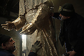 Gliwice, Poland, March 4, 2011:.Wieslaw Bochynski and Kazimierz Janicki, workers at the GZUT factory that specializes in making the bronze monuments, by the head of pope John Paul 2 monument.. (Photo by Piotr Malecki / Napo Images)..Gliwice, 4/03/2011:.Wieslaw Bochynski i Kazimierz Janicki, pracownicy odlewni GZUT, pracuja nad nowym pomnikiem papieza Jana Pawla II.Fot: Piotr Malecki / Napo Images