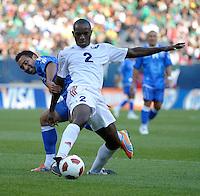 Cuba's Carlos Domingo Francisco plays the ball while being pressured by El Salvador's Arturo Alvarez.  El Salvador defeated Cuba 6-1 at the 2011 CONCACAF Gold Cup at Soldier Field in Chicago, IL on June 12, 2011.