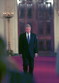 United States President Bill Clinton walks to the East Room in the White House in Washington, D.C. to hold a press conference on March 29, 2000. .Credit: Arnie Sachs / CNP
