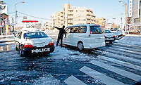 Tokyo Police use their cars to close off major road due to dangerous black ice conditions.