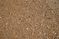 9 June 2006:  Wet sand detail along the Atlantic Ocean beach scene along the Outerbanks in North Carolina after a passing storm. Surf crashes along the beach on wet sand and dark blue skies. Graphic, art, scenic view east coast.