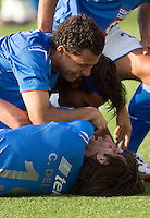 Miguel Sabah (L), Alejandro Corona and Cesar Delgado huddle over Gabriel Pereyra after scoring a goal against Veracruz Tiburones Rojos during their soccer match at Azul Stadium, April 08, 2006.Cruz Azul won 3-0 to Veracruz...  © Photo by Javier Rodriguez