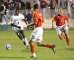 14 December 2007: Wake Forest's Marcus Tracy (9) is chased by Virginia Tech's Ben Nason (14). The Wake Forest University Demon Deacons defeated the Virginia Tech University Hokies 2-0 at SAS Stadium in Cary, North Carolina in a NCAA Division I Men's College Cup semifinal game.