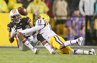 Sep 21, 2013; Baton Rouge, LA, USA; LSU Tigers cornerback Dwayne Thomas (13) breaks up a pass intended for Auburn Tigers wide receiver Ricardo Louis (5) in the second quarter at Tiger Stadium. Mandatory Credit: Crystal LoGiudice-USA TODAY Sports