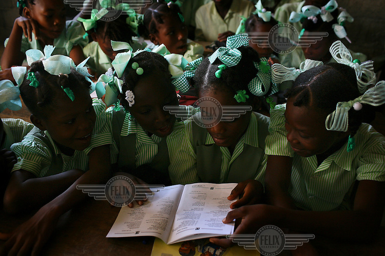 Pupils make role play and learn songs which teach them how to protect the environment at the Ecole Evangelie of Haiti school in Limbe. Part of Oxfam's Disaster Risk Reduction Work.