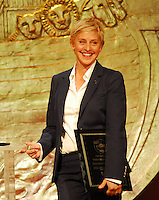 Ellen Degeneres and her wife Portia deRossi accept the Wyler Award for their work with the Humane Society at the 23rd Annual Genesis Awards Saturday night March 28,2009.Photo&copy; Suzi Altman. ALL IMAGES &copy;SUZI ALTMAN. IMAGES ARE NOT PUBLIC DOMAIN. CALL OR EMAIL FOR LICENSE, USE, OR TO PURCHASE PRINTS 601-668-9611 OR EMAIL SUZISNAPS@AOL.COM