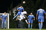 16 September 2016: North Carolina's Mauricio Pineda (2) heads the ball over Pitt's Roosevelt Angulo (CAN) (17). The University of North Carolina Tar Heels hosted the University of Pittsburgh Panthers in Chapel Hill, North Carolina in a 2016 NCAA Division I Men's Soccer match. UNC won the game 1-0.