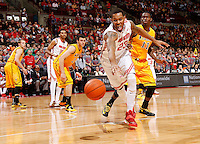 Ohio State Buckeyes center Amir Williams (23) loses the handle on the ball while being guarded by Wyoming Cowboys forward Derek Cooke Jr. (11) during the second half of the NCAA basketball game at Value City Arena in Columbus on Nov. 25, 2013. The Buckeyes won 65-50. (Adam Cairns / The Columbus Dispatch)