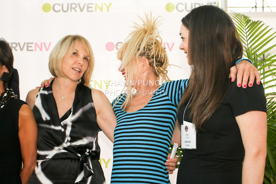Carole Hochman, Betsey Johnson, and guest laugh on stage at the CURVE and CFDA Party For A Cause event during the CURVENY Lingerie &amp; Swim show, at the Jacob Javits Convention Center, August 2, 2010.