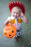 Two year-old Bailey Bauman dresses up as a cowgirl for trick-or-treating in downtown Los Altos Oct. 31.<br />
